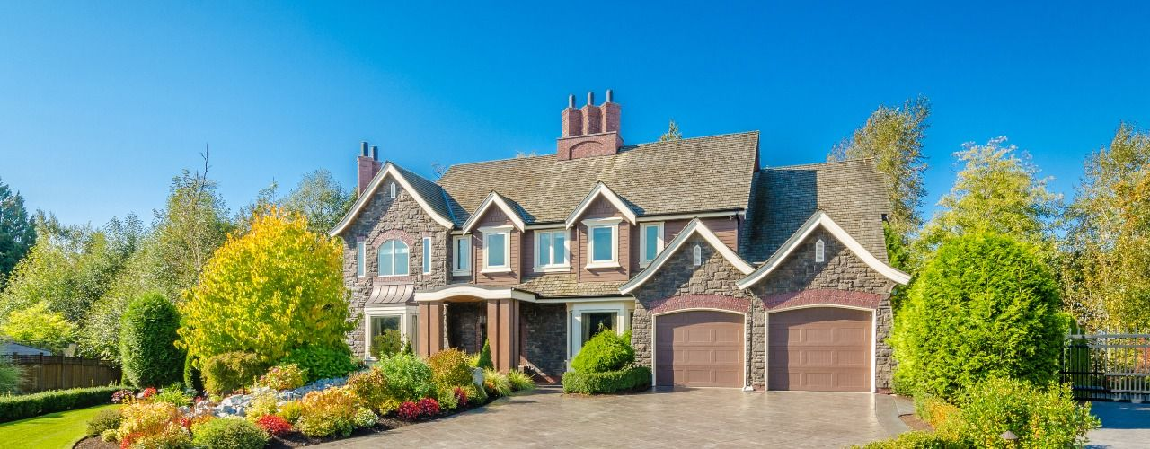 Photo of a beautiful large home with 2 car garage and nice landscaping
